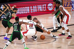 Miami Heat's Bam Adebayo (13) and Boston Celtics' Daniel Theis (27) battle for the ball during the second half of an NBA conference final playoff basketball game Friday, Sept. 25, 2020, in Lake Buena Vista, Fla. The Celtics won 121-108. (AP Photo/Mark J. Terrill)