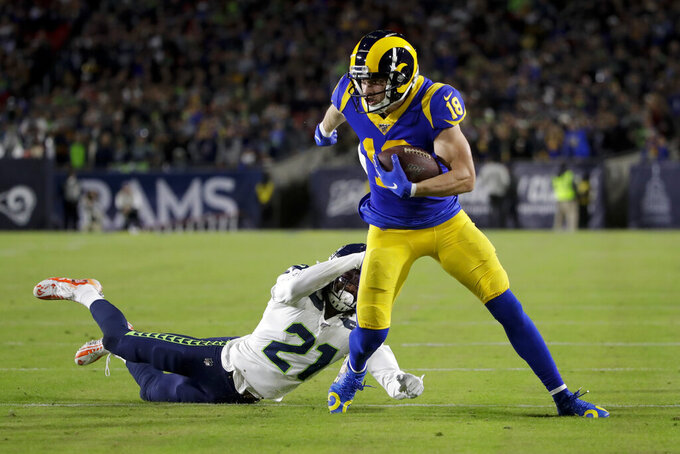 Los Angeles Rams wide receiver Cooper Kupp breaks away form Seattle Seahawks cornerback Tre Flowers during the first half of an NFL football game Sunday, Dec. 8, 2019, in Los Angeles. (AP Photo/Marcio Jose Sanchez)