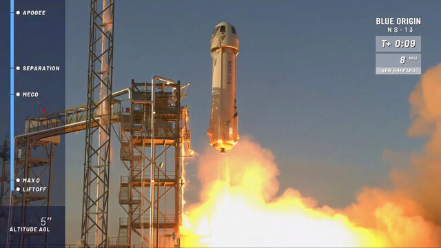 In this image from video made available by Blue Origin, the New Shepard rocket lifts off from its launchpad in Texas, to test new lunar-landing technology for NASA that could help put astronauts back on the moon by 2024. (Blue Origin via AP)