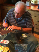 In this June 2019 photo provided by Karen Gooch, former Green Bay Packers football player Bobby Dillon autographs football cards at his home in Temple, Texas. Dillon was one of the best defensive players in the league. But the Packers were an NFL weakling at the time, going  33-61-2 while Dillon was playing safety so well he made four All-Pro teams and intercepted 52 passes. Dillon passed away at age 89 in August 2019, five months before he was selected for the Hall of Fame as part of the centennial class. (Karen Gooch via AP)
