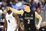 Georgetown guard Mac McClung (2) gestures after he scored a basket during the first half of an NCAA college basketball game against Villanova, Wednesday, Feb. 20, 2019, in Washington. (AP Photo/Nick Wass)