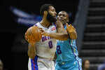 Detroit Pistons center Andre Drummond, left, looks to pass the ball as Charlotte Hornets center Bismack Biyombo defends during the first half of an NBA basketball game in Charlotte, N.C., Friday, Nov. 15, 2019. (AP Photo/Nell Redmond)