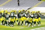 Green Bay Packers players help Preston Smith celebrate his touchdown on a fumble recovery during the first half of an NFL football game against the Chicago Bears Sunday, Nov. 29, 2020, in Green Bay, Wis. (AP Photo/Mike Roemer)