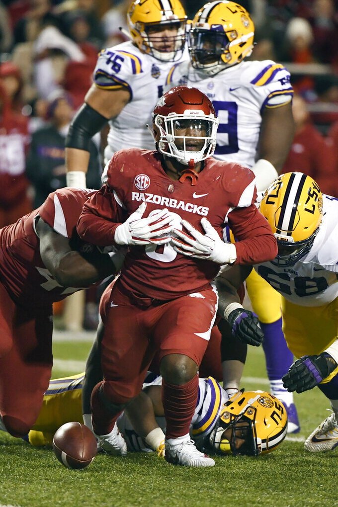 FILE - In this Nov. 10, 2018, file photo, Arkansas defensive back De'Jon Harris celebrates after a tackle against LSU during the second half of an NCAA college football game in Fayetteville, Ark. The Razorbacks did not win an SEC game in coach Chad Morris' first season, but Harris was one of the best _ and busiest _ linebackers in the conference. Harris led the SEC in tackles with 118. (AP Photo/Michael Woods, File)