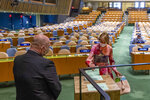 United States ambassador to the United Nations, Kelly Craft, right, casts a vote during U.N. elections, Wednesday, June 17, 2020, at U.N. headquarters in New York. Norway and Ireland won contested seats on the powerful U.N. Security Council Wednesday in a series of U.N. elections held under dramatically different voting procedures because of the COVID-19 pandemic. (Eskinder Debebe/UN Photo via AP)