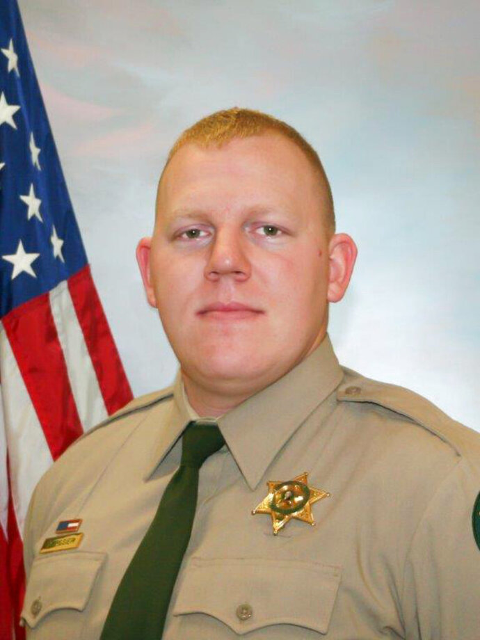 Cowlitz County Sheriff's Office Deputy Justin DeRosier, 29, was shot and killed Saturday, April 13, 2019, while checking on a disabled vehicle northeast of Kalama, Wa.. (Cowlitz County Sheriff's Office/The Columbian via AP)
