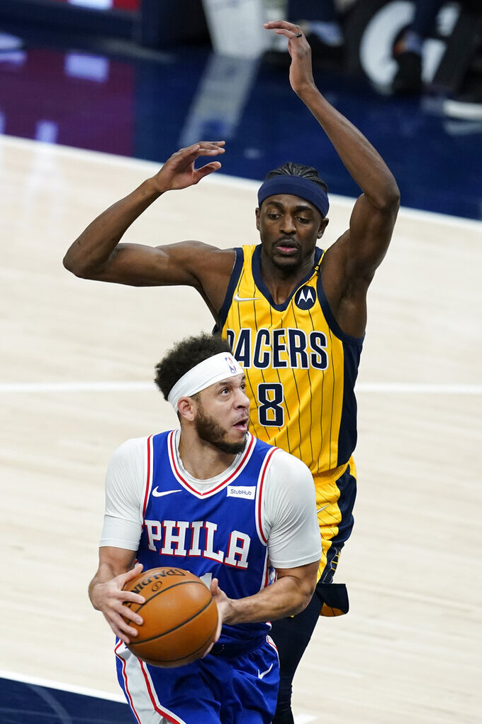 Philadelphia 76ers' Seth Curry (31) goes goes to the basket against Indiana Pacers' Justin Holiday (8) during the first half of an NBA basketball game, Tuesday, May 11, 2021, in Indianapolis. (AP Photo/Darron Cummings)