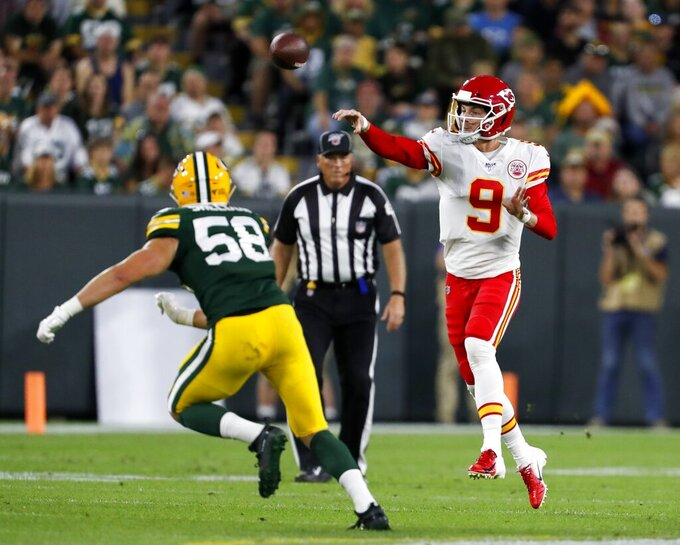 Kansas City Chiefs' Kyle Shurmur throws past Green Bay Packers' Brady Sheldon during the first half of a preseason NFL football game Thursday, Aug. 29, 2019, in Green Bay, Wis. (AP Photo/Matt Ludtke)