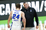 Creighton head coach Greg McDermott talks with Mitch Ballock (24) during the second half of a college basketball game against UC Santa Barbara in the first round of the NCAA tournament at Lucas Oil Stadium in Indianapolis Saturday, March 20, 2021. (AP Photo/Mark Humphrey)