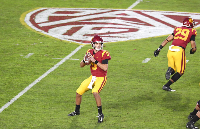 Southern California quarterback Kedon Slovis (9) looks to pass against Washington State in the first half of an NCAA college football game in Los Angeles, Sunday, Dec. 6, 2020. (Keith Birmingham/The Orange County Register via AP)