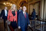 In this Jan. 10, 2019, photo, Vice President Mike Pence and counselor to the President Kellyanne Conway, leave Pence's office off the Senate floor in the Capitol building in Washington. (AP Photo/Andrew Harnik)