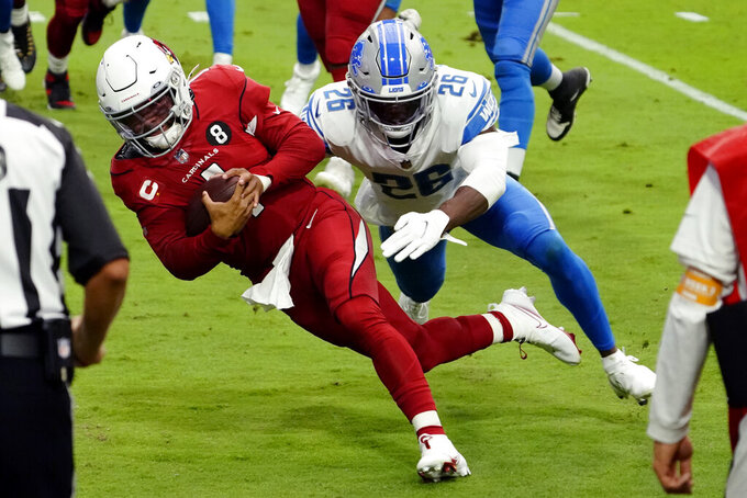 Arizona Cardinals quarterback Kyler Murray lunges for the end zone for a touchdown as Detroit Lions strong safety Duron Harmon (26) defends during the first half of an NFL football game, Sunday, Sept. 27, 2020, in Glendale, Ariz. (AP Photo/Rick Scuteri)