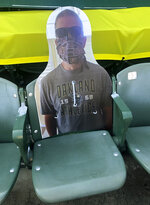 A cardboard cutout depicting A's fan Richard Lovelady of Henderson, Nev., is displayed in a section of the Oakland Coliseum after the baseball game between the Los Angeles Angels and the Oakland Athletics on Monday, July 27, 2020, in Oakland, Calif. An approach taken by some teams is sending out souvenirs to fans if their cardboard cutout gets hit by a ball.  The Longtime A's supporter lucked out last Friday night when his cutout — section 126, row 24, seat 4 — was struck by Matt Olson's foul.(AP Photo/Ben Margot)