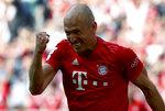 Bayern's Arjen Robben celebrates after scoring his side's 5th goal during the German Bundesliga soccer match between FC Bayern Munich and Eintracht Frankfurt in Munich, Germany, Saturday, May 18, 2019. (AP Photo/Matthias Schrader)