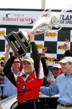 FILE - In this March 11, 2001, file photo, Kevin Harvick holds up the trophy in Victory Lane after winning the NASCAR Cracker Barrel 500 auto race at Atlanta Motor Speedway in Hampton, Ga. Harvick returns to Atlanta Motor Speedway for the 20th anniversary of his emotional first Cup victory. (AP Photo/Ric Feld,File)