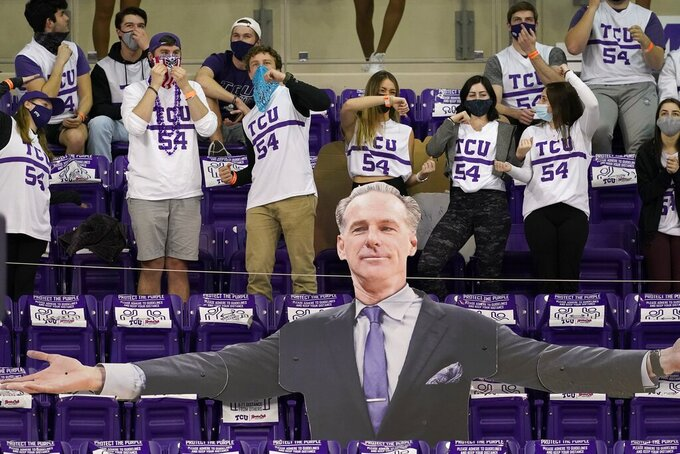 TCU fans cheer on their team as they stand behind a large cut-out in the likeness of head coach Jamie Dixon in the first half of an NCAA college basketball game against Oklahoma State in Fort Worth, Texas, Wednesday, Feb. 3, 2021. (AP Photo/Tony Gutierrez)