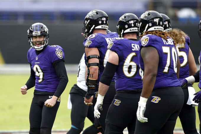 Baltimore Ravens place kicker Justin Tucker (9) reacts after kicking a field goal against the Jacksonville Jaguars during the first half of an NFL football game, Sunday, Dec. 20, 2020, in Baltimore. (AP Photo/Gail Burton)