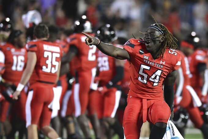 Texas Tech linebacker Bryce Ramirez (54) celebrates after defeating Baylor in an NCAA college football game in Lubbock, Texas, Saturday, Nov. 14, 2020. (AP Photo/Justin Rex)