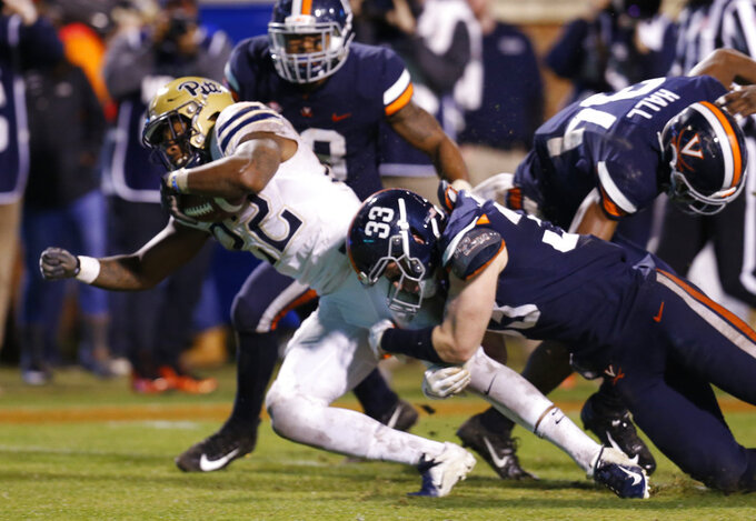 Pittsburgh running back Darrin Hall (22) lunges into the end zone for a score as Virginia linebacker Zane Zandier (33) holds on during the second half of an NCAA college football game in Charlottesville, Va., Friday, Nov. 2, 2018. (AP Photo/Steve Helber)