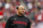 FILE - In this Nov. 16, 2019, file photo, Stanford head coach David Shaw looks on during the first half of an NCAA college football game against Washington State in Pullman, Wash. Colleges around the country finished off their football signing classes this week, proudly touting scores of African-American athletes as their next big stars. A review of all 130 FBS schools found shockingly low numbers, with blacks still largely shut out of head coaching positions and even more so the prime coordinator spots.   (AP Photo/Young Kwak, File)