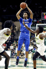 Memphis guard Jayden Hardaway (25) shoots over South Florida guard Ezacuras Dawson III (2) during the first half of an NCAA college basketball game Sunday, Jan. 12, 2020, in Tampa, Fla. (AP Photo/Chris O'Meara)