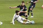 Philadelphia Union's Kai Wagner watches as New England Revolution's Henry Kessler slides for the ball during an MLS soccer playoff match Tuesday, Nov. 24, 2020, in Chester, Pa. (Charles Fox/The Philadelphia Inquirer via AP)