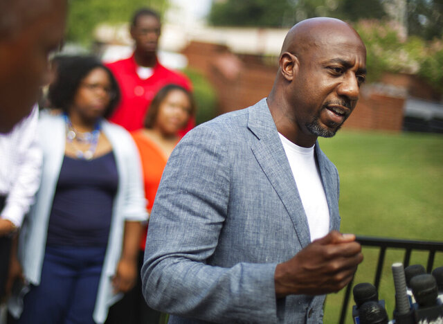 FILE - In this July 30, 2015 file photo, Rev. Raphael G. Warnock, pastor of Ebenezer Baptist Church, right, speaks during a press conference after Confederate flags were found on the church's premises in Atlanta. Warnock announced his campaign for the U.S. Senate on Thursday, Jan. 30, 2020 challenging recently appointed Republican Kelly Loeffler. (AP Photo/David Goldman, File)