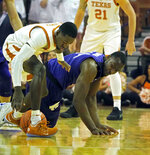 Texas guard Courtney Ramey, left, fights for the loose ball with Kansas State forward Makol Mawien, right, during the first half of an NCAA college basketball game, Tuesday, Feb. 12, 2019, in Austin, Texas. (AP Photo/Michael Thomas)