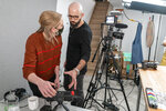 In this Oct. 7, 2020 photo, producer Jessica Opon, left, and Andrew Rea, founder of the Binging with Babish network, go over the framing of a scene during a taping of the