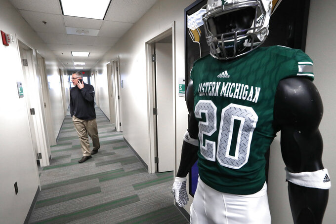 Eastern Michigan football coach Chris Creighton talks with an assistant in preparation for the Camellia Bowl, in Ypsilanti, Mich., Monday, Dec. 10, 2018. The Eagles will face Georgia Southern in the Camellia Bowl on Saturday, earning a spot in NCAA football postseason play for the second time in three years and just the third time in school history. (AP Photo/Paul Sancya)