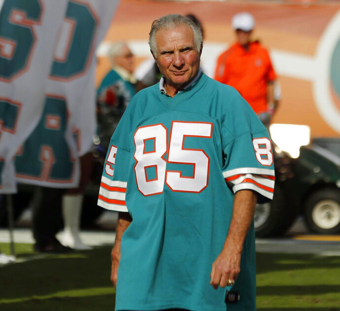 FILE - In this Dec. 16, 2012, file photo, Nick Buoniconti, former Miami Dolphins player and member of the 1972 undefeated team, in introduced during the half time show of an NFL football game against the Jacksonville Jaguars, in Miami. Pro Football Hall of Fame middle linebacker Nick Buoniconti, an undersized overachiever who helped lead the Miami Dolphins to the NFL's only perfect season, has died at the age of 78. Bruce Bobbins, a spokesman for the Buoniconti family, said he died Tuesday, July 30, 2019, in Bridgehampton, N.Y. (AP Photo/John Bazemore, FIle)