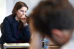 Sarah Moriarty, the daughter of Robert Levinson, a U.S. hostage in Iran, listens during a news conference about hostages in Iran, Tuesday, Dec. 3, 2019, in Washington. (AP Photo/Jacquelyn Martin)