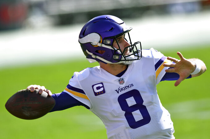 Minnesota Vikings quarterback Kirk Cousins (8) warms up before an NFL football game against the Tampa Bay Buccaneers Sunday, Dec. 13, 2020, in Tampa, Fla. (AP Photo/Jason Behnken)