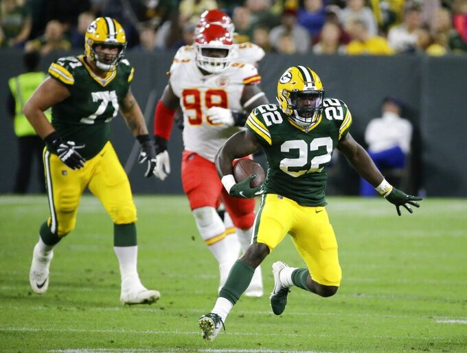 Green Bay Packers' Dexter Williams runs during the second half of a preseason NFL football game against the Kansas City Chiefs Thursday, Aug. 29, 2019, in Green Bay, Wis. (AP Photo/Mike Roemer)