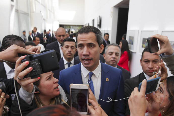Venezuela's opposition leader Juan Guaido speaks to journalists during a regional counter-terrorism meeting at the police academy in Bogota, Colombia, Monday, during a ceremony marking one year since a car bomb attack at the school, Monday, Jan. 20, 2020. Also in attendance were Colombia's President Ivan Duque and US Secretary of State Mike Pompeo. (AP Photo/Ivan Valencia)