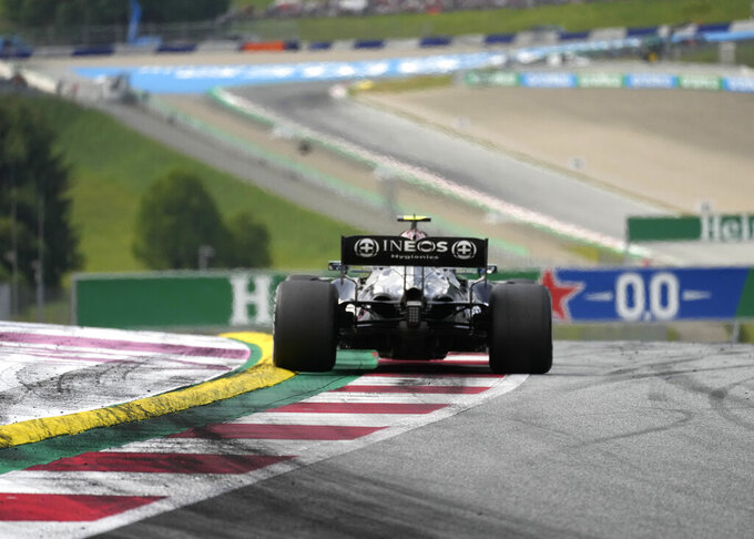 Mercedes driver Valtteri Bottas of Finland steers his car during the Austrian Formula One Grand Prix at the Red Bull Ring racetrack in Spielberg, Austria, Sunday, July 4, 2021. (AP Photo/Darko Bandic)