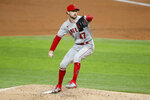 Los Angeles Angels starting pitcher Griffin Canning throws to the Texas Rangers in the second inning of a baseball game in Arlington, Texas, Friday, Aug. 7, 2020. (AP Photo/Tony Gutierrez)