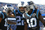 Carolina Panthers wide receiver D.J. Moore, left, running back Christian McCaffrey (22) and Carolina Panthers wide receiver Curtis Samuel (10) celebrate Samuel's touchdown against the Washington Redskins during the first half of an NFL football game in Charlotte, N.C., Sunday, Dec. 1, 2019. (AP Photo/Brian Blanco)