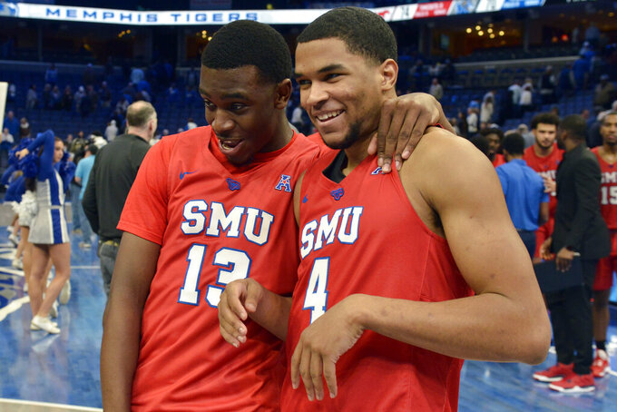 SMU guards CJ White (13) and Charles Smith IV (4) celebrate after defeating Memphis in an NCAA basketball game Saturday, Jan. 25, 2020, in Memphis, Tenn. (AP Photo/Brandon Dill)