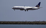 FILE - In this July 11, 2017, file photo, a United Airlines plane lands at San Francisco International Airport. A dog died on a United Airlines plane after a flight attendant ordered its owner to put the animal in the plane's overhead bin. United said Tuesday, March 13, 2018, that it took full responsibility for the incident on the Monday night flight from Houston to New York. In a statement, United called it