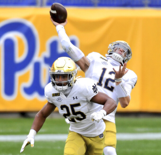 Notre Dame quarterback Ian Book drops back to pass against Pittsburgh in the first quarter of an NCAA college football game, Saturday, Oct. 24, 2020, in Pittsburgh. (Matt Freed/Pittsburgh Post-Gazette via AP)