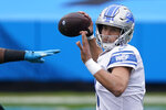 Detroit Lions quarterback Matthew Stafford passes against the against the Carolina Panthers during the first half of an NFL football game Sunday, Nov. 22, 2020, in Charlotte, N.C. (AP Photo/Gerry Broome)