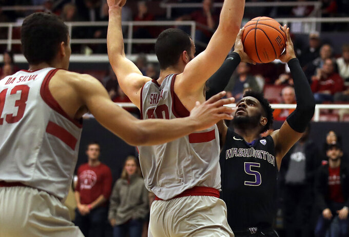 Washington's Jaylen Nowell, right, shoots against Stanford's Josh Sharma and Oscar Da Silva (13) in the second half of an NCAA college basketball game Sunday, March 3, 2019, in Stanford, Calif. (AP Photo/Ben Margot)