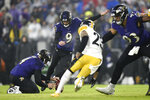 Baltimore Ravens kicker Justin Tucker (9), with Sam Koch holding, kicks a field goal against the Pittsburgh Steelers during the first half of an NFL football game, Sunday, Dec. 29, 2019, in Baltimore. (AP Photo/Gail Burton)