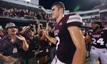 Mississippi State quarterback Nick Fitzgerald (7) and cornerback Chris Rayford (24) celebrate with fans after the team's 23-9 win over Auburn in an NCAA college football game in Starkville, Miss., Saturday, Oct. 6 2018. (AP Photo/Rogelio V. Solis)
