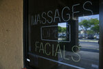 In this March 26, 2019 photo, shows the front entrance of the Orchids of Asia Day Spa in Jupiter, Fla. Attorneys for two Florida massage parlor employees plan to ask a judge to hold police and prosecutors responsible for the possible unauthorized release of video that they say shows New England Patriots owner Robert Kraft paying for sex. (AP Photo/Brynn Anderson)
