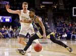 Wake Forest's Andrien White, right, drives in next to Notre Dame's Rex Pflueger (0) during the second half of an NCAA college basketball game Wednesday, Jan. 29, 2020, in South Bend, Ind. Notre Dame won 90-80. (AP Photo/Robert Franklin)