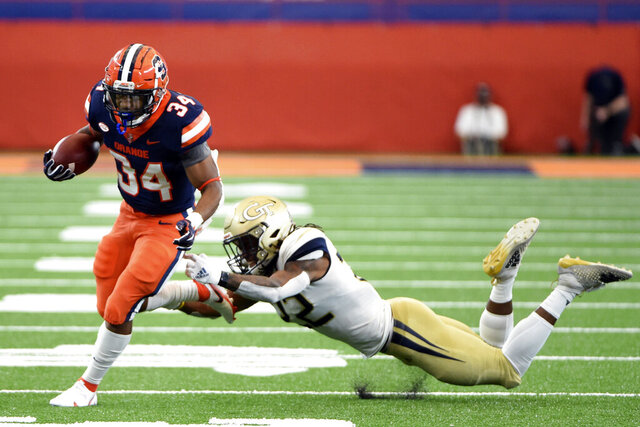 Syracuse running back Sean Tucker (34) breaks away from a Georgia Tech defender for a long run during an NCAA college football game, Saturday, Sept. 26, 2020, at the Carrier Dome in Syracuse, N.Y. (Dennis Nett/The Post-Standard via AP)