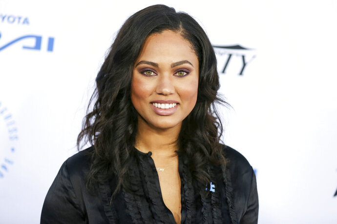 FILE - In this Oct. 8, 2015 file photo, Ayesha Curry arrives at the Autism Speaks to LA Celebrity Chef Gala in Santa Monica, Calif. Curry is currently working on her second cookbook among her other projects, and has been testing out new recipes using her family as her guinea pigs. (Photo by Rich Fury/Invision/AP, File)