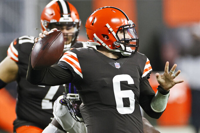 Cleveland Browns quarterback Baker Mayfield looks to throw during the first half of an NFL football game against the Baltimore Ravens, Monday, Dec. 14, 2020, in Cleveland. (AP Photo/Ron Schwane)